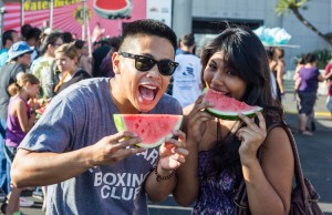 Fans enjoying watermelons at the 52nd Annual Watermelon Festival at the Rose Bowl in Pasadena in 2013. This year's festival is scheduled to be in July. (Rafael Orellana/Living Out Loud LA)