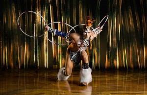 """Eric Hernandez, pictured, showcases his hoop dancing skills in Cirque du Soleil's """"Totem."""" (Courtesy of OSA Images)"""