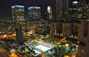 The skyline twinkling above Pershing Square provides a beautiful atmosphere for some spins around the Downtown on Ice rink. (Downtown on Ice)