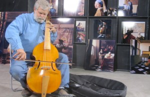 In his warehouse in San Antonio, Texas, Tim Jenison plays the viola de gamba he used to furnish his Vermeer room. (Natalie Jenison/Sony Pictures Classics)