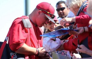 Mike Trout, pictured here signing autographs, has agreed to a 1-year, $1 million contract with the Angels. (Facebook/Los Angeles Angels of Anaheim)