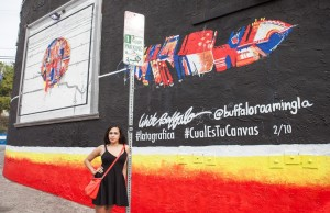 Renelle White Buffalo, pictured, painted her mural at Club Los Globos in Silver Lake. (Carlos Torres Garzon)