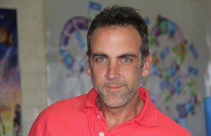 Carlos Ponce poses for pictures on Friday, March 21 at the East LA Boys & Girls Club. (Marvin Vasquez/Living Out Loud LA)
