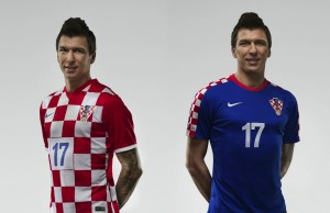 Croatian striker Mario Mandzukic models the country's 2014 World Cup jerseys.