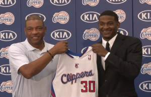 Coach Doc Rivers welcomed the newest Clipper, rookie C.J. Wilcox, to the team Monday morning. (nba.com/clippers)