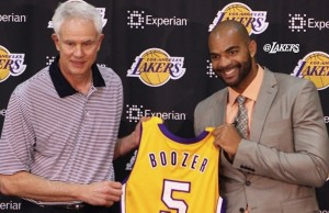 Lakers GM Mitch Kupchak presents the team's newest member, Carlos Boozer, with his new jersey. (Instagram)