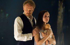 Professor Coupland (Jared Harris) and Jane Harper (Olivia Cooke) in The Quiet Ones (Lionsgate)
