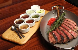 One bite just isn't enough when it comes to a juicy sliced steak and array of sauces at STK LA.