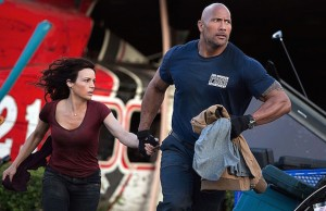 Carla Gugino and Dwayne Johnson seek safety in San Andreas. (Jasin Boland/Warner Bros. Entertainment)