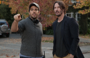 Director Eli Roth and Keanu Reeves on the set of Knock Knock (Lionsgate Premiere)