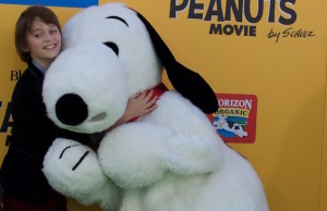 Noah Schnapp, who voices Charlie Brown, with Snoopy at The Peanuts Movie premiere in Westwood. (Keziah Arnold)