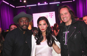 will.i.am, Olivia Munn and T-Mobile CEO John Legere at the Shrine Auditorium