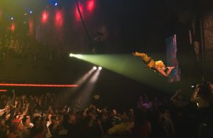 Lil' Chicken diving off a speaker stand into the crowd at Lucha VaVOOM (Taylor Wong/LOL-LA)