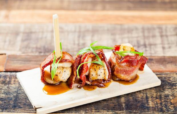 Get your fill of a fun atmosphere, cool cocktails and bacon, bacon, bacon at Saint Marc.